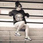 Millie Manders in #notacult sweatshirt