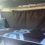 Primordial Radio Inkubus Camper - top bunk with bedding